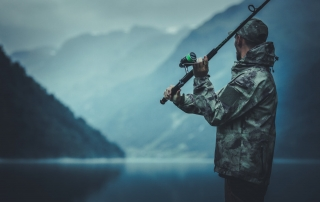 An angler casts while fishing in Alaska at the famed Elfin Cove.